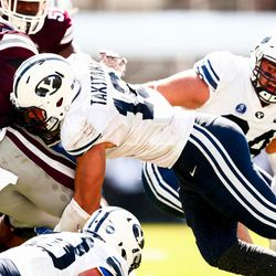 BYU defensive end Sione Takitaki (16) tackles Mississippi State running back Aeris Williams at Davis Wade Stadium in Starkville, Miss., on Saturday, Oct. 14, 2017.