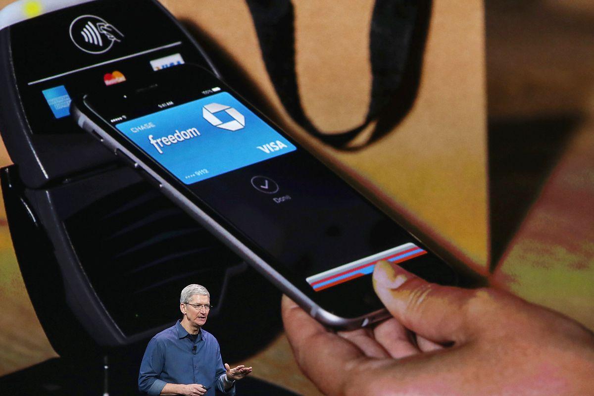 Tim Cook explaining Apple Pay, via Getty