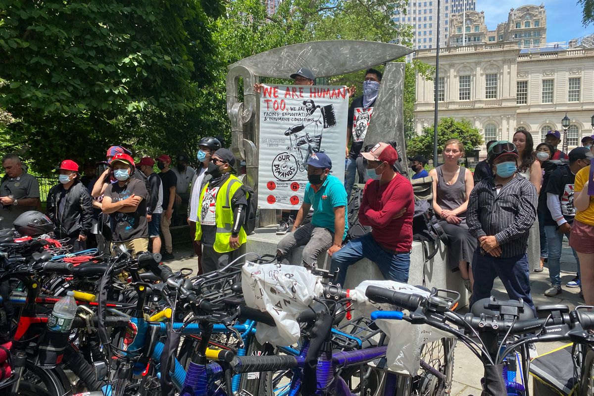 Delivery workers rallied outside City Hall while the City Council debated ways to provide more benefits, June 8, 2021.