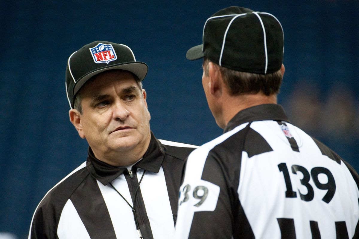 Aug 30, 2012; Detroit, MI, USA; NFL replacement referee Tom Falcinelli (left) talks with Henry Zaborniak (right) before the preseason game between the Detroit Lions and the Buffalo Bills at Ford Field. Mandatory Credit: Tim Fuller-US PRESSWIRE