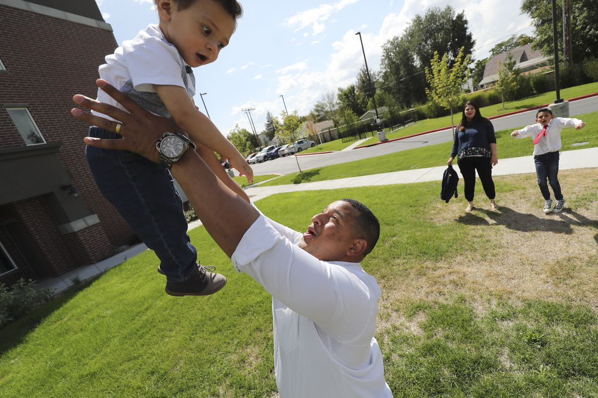 Carlos Moreno tosses his son Carlos Rodrigo as his wife Norbelys and son Carlos Isaias watch in Midvale on Monday, Sept. 9, 2019.