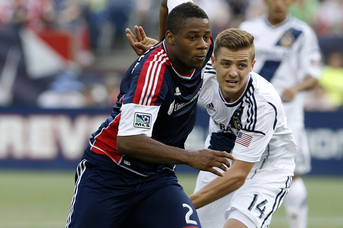 New England Revolution defender Andrew Farrell (2) works the ball against Los Angeles Galaxy Robbie Rogers (14) during the second half at Gillette Stadium. The New England Revolution defeated the Los Angeles Galaxy 5-0.