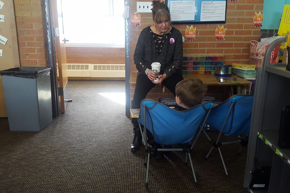 Principal Stacy Bedell listens to a student at Eiber Elementary in Jeffco Public Schools.