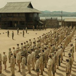 """The Allied prisoners are lined up in formation in the Omori POW camp in """"Unbroken,"""" an epic drama that follows the incredible life of Olympian and war hero Louis """"Louie"""" Zamperini who, along with two other crewmen, survived in a raft for 47 days after a near-fatal plane crash in WWII — only to be caught by the Japanese Navy and sent to a prisoner-of-war camp."""