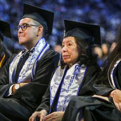 Salt Lake Community College graduates of excellence listen to speakers during the 2017 commencement ceremony at the Maverik Center in West Valley City on Friday, May 5, 2017.