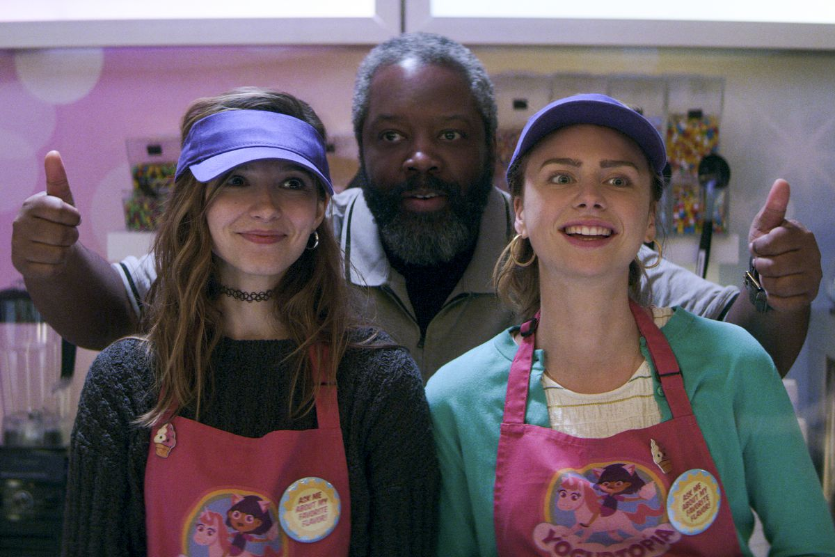 sterling and blair in yogurt shop uniforms, bowser behind them