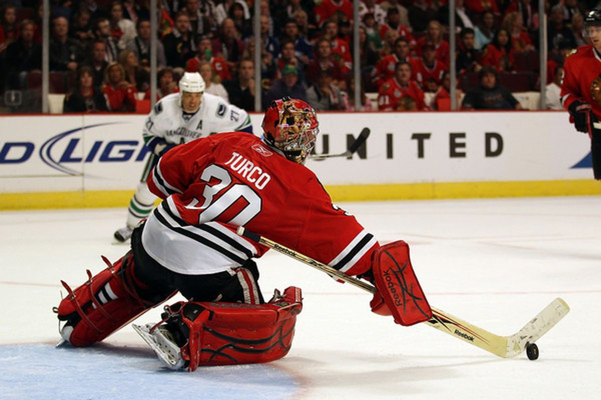 Marty Turco of the Blackhawks makes a save in the 3rd period against the Vancouver Canucks at the United Center on October 20 2010 in Chicago. The Blackhawks defeated the Canucks 2-1 in a shootout. (Photo by Jonathan Daniel/Getty Images)