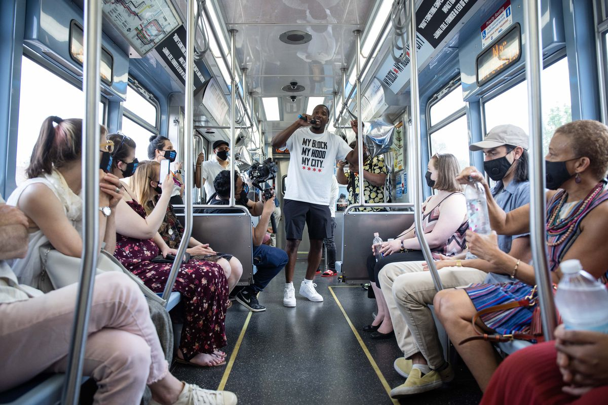 My Block My Hood My City founder Jahmal Cole speaks on a Red Line train as it heads to the South Side Saturday afternoon. The group held a fashion show that occupied two rail cars to promote their new merchandise and raise funds for the organization.