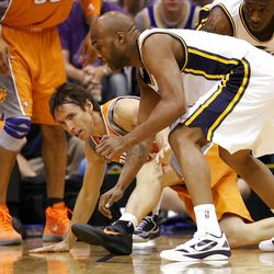 Utah Jazz guard Jamaal Tinsley (6) forces Phoenix Suns guard Steve Nash (13) to lose the ball out of bounds as the Utah Jazz and the Phoenix Suns play Tuesday, April 24, 2012 in Energy Solutions arena.