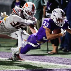 Lehi's Carson Gonzalez carries the ball as he dives into the end zone for a touchdown during a high school football game against Timpview at Lehi High School in Lehi on Friday, Sept. 25, 2020.