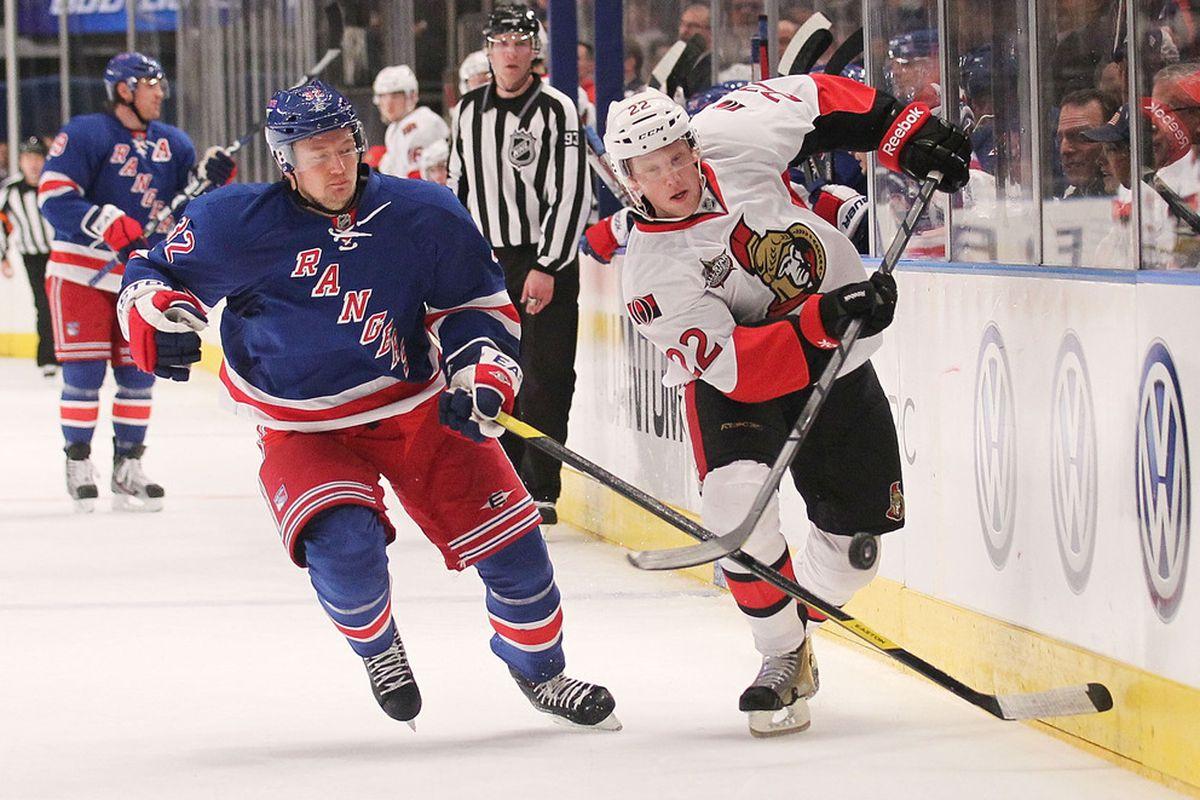 NEW YORK, NY - JANUARY 12: Erik Condra #22 of the Ottawa Senators skates under pressure from Anton Stralman #32 of the New York Rangers at Madison Square Garden on January 12, 2012 in New York City.  (Photo by Nick Laham/Getty Images)