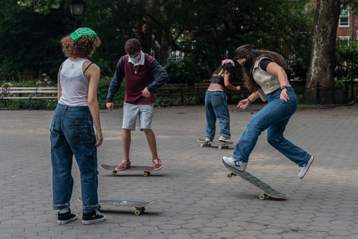 A group of new skateboarders attempt to land their first trick at Washington Square Park, July 17, 2020.