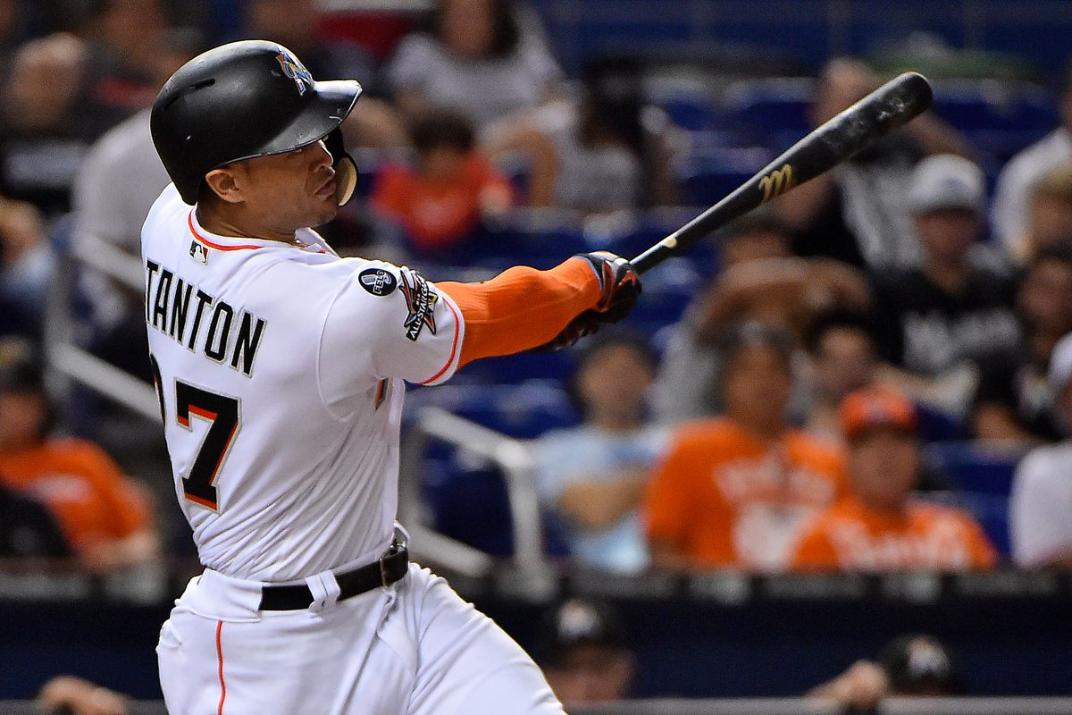 Miami Marlins right fielder Giancarlo Stanton (27) connects for a solo home run in the fourth inning against the Atlanta Braves at Marlins Park