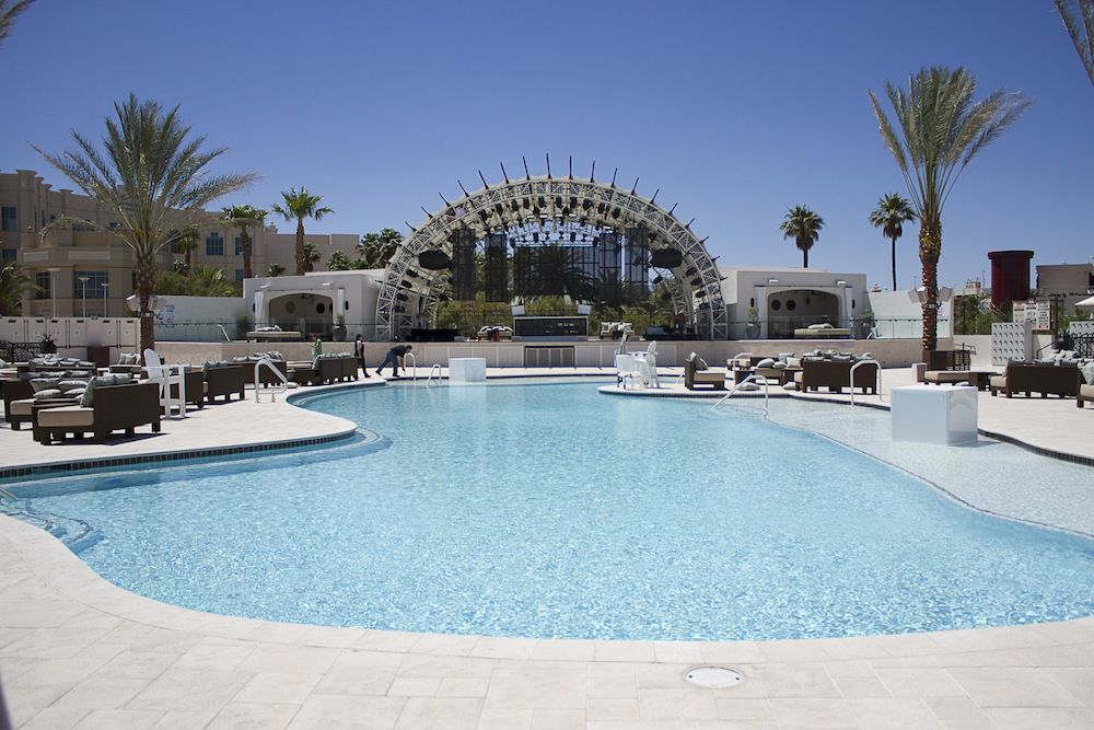 Pool with lounge chairs and stage