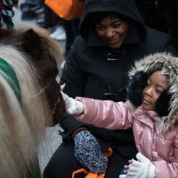 Savannah Henderson, 4, pets a miniature horse from Soul Harbour Ranch at the 85th Annual Thanksgiving Day Parade on November 22, 2018   Max Herman/For the Sun-Times