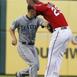 Texas Rangers' Adrian Beltre (29) is tagged out in a rundown between second and third by Seattle Mariners third baseman Kyle Seager during the second inning of a baseball game Tuesday, April 10, 2012,  in Arlington, Texas.