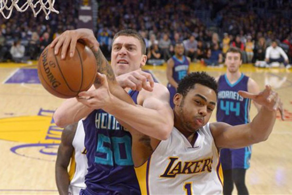 Charlotte Hornets forward Tyler Hansbrough, left, and Los Angeles Lakers guard D'Angelo Russell battle for a rebound during the first half of an NBA basketball game, Sunday, Jan. 31, 2016, in Los Angeles. (AP Photo/Mark J. Terrill)