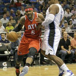 Atlanta Hawks' Josh Smith (5) drives past Orlando Magic's Glen Davis during the first half of an NBA basketball game on Friday, April 13, 2012, in Orlando, Fla.