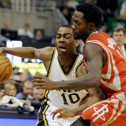 Utah Jazz point guard Alec Burks (10) tries to drive down court as Houston Rockets point guard Patrick Beverley (2) applies pressure during a game at EnergySolutions Arena on Monday, December 2, 2013.