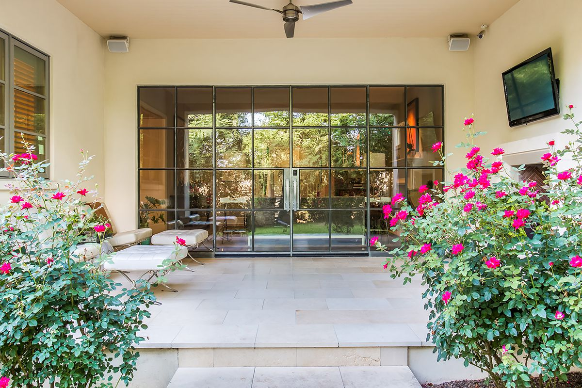 Backyard terrace with roses and glass doors