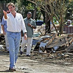 Vice President Dick Cheney, left, and Gulfport Mayor Brent Warr check out the damage from the hurricane and flooding as they walk down a street in Gulfport, Miss.