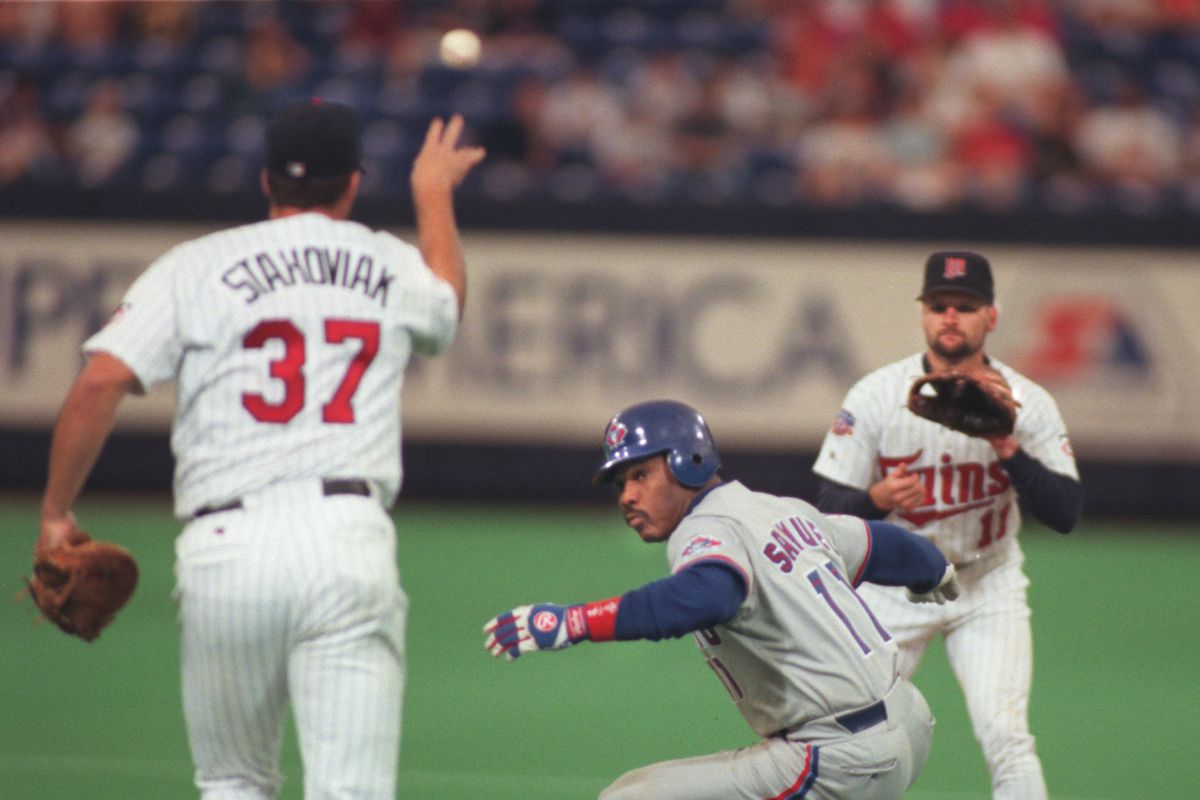 Twins vs Toronto. Toronto's #11 Juan Samuel got caught in a rundown in the 6th inning between the Twin's #37 Scott Stahoviak and #11 Chuck Knoblauch. Samuel was tagged out.