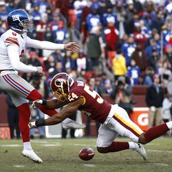 Washington Redskins linebacker Nate Orchard, right, blocks a punt attempt by New York Giants punter Riley Dixon during the second half of an NFL football game, Sunday, Dec. 22, 2019, in Landover, Md.