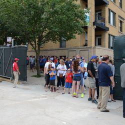 5:01 p.m. Bleacher gate line snaking inside the construction gate on Waveland -