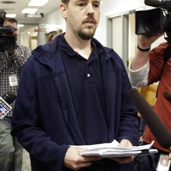 Josh Powell, the husband of missing Utah woman Susan Powell, is surrounded by reporters as he leaves a Pierce County courtroom, Friday, Sept. 23, 2011, in Tacoma, Wash. Powell was attending a hearing regarding a motion for custody of his two children that was filed by his father-in-law, Chuck Cox.