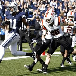 Brigham Young Cougars wide receiver Ross Apo runs for a touchdown as Brigham Young University faces Idaho State in NCAA football in Provo, Saturday, Oct. 22, 2011.