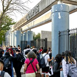 Students congregate at the entrance of Pan American High School on the first day of classes.