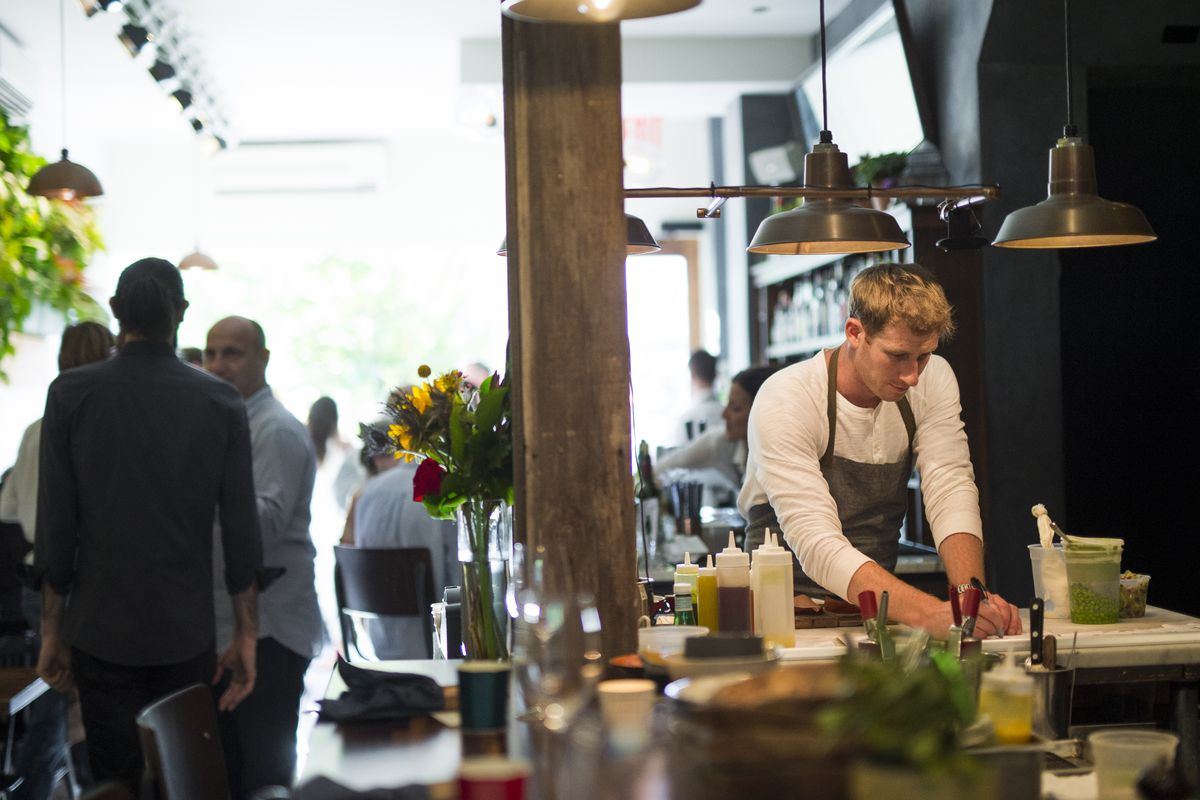 Olmsted chef Greg Baxtrom in his EXTREMELY PACKED restaurant
