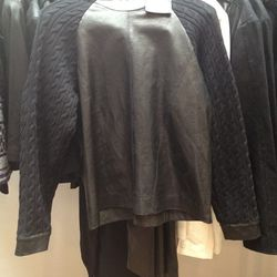 Leather sweater with knit sleeves, $125