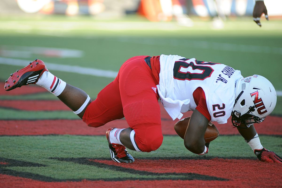 NIU's Keith Harris tumbles into the endzone late in the second quarter