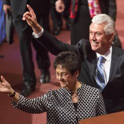 President Dieter F. Uchtdorf and his wife Harriet wave to the audience following the Saturday morning session of the 183rd Semiannual General Conference for the Church of Jesus Christ of Latter-day Saints Saturday, Oct. 5, 2013 inside the Conference Center.