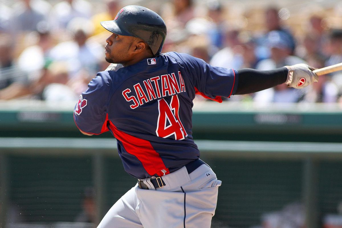 Mar 27, 2012; Glendale, AZ, USA; Cleveland Indians first baseman Carlos Santana (41)  grounds out to end the top of the first inning against the Chicago White Sox at Camelback Ranch.  Mandatory Credit: Jake Roth-US PRESSWIRE