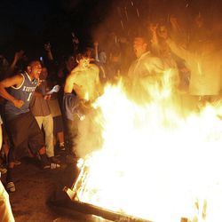 Kentucky fans dance around a fire on State Street as they celebrate Kentucky's 69-61 win over Louisville in an NCAA Final Four semifinal college basketball tournament game, Saturday, March 31, 2012, in Lexington, Ky.