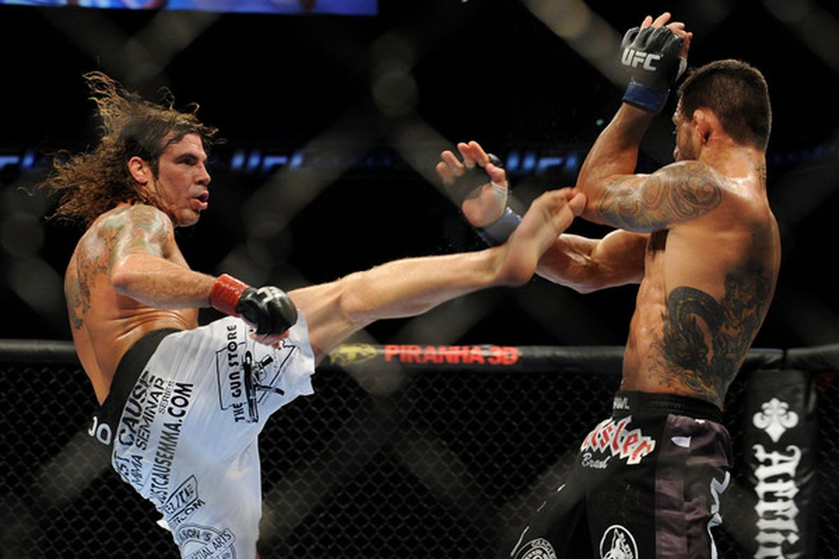 OAKLAND CA - AUGUST 07:  Clay Guida kicks Rafael dos Anjos during the UFC Lightweight bout at Oracle Arena on August 7 2010 in Oakland California.  (Photo by Jon Kopaloff/Zuffa LLC/Zuffa LLC via Getty Images)