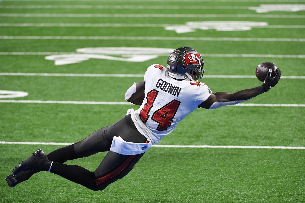 Chris Godwin #14 of the Tampa Bay Buccaneers makes a seven yard reception for a touchdown during the second quarter of a game against the Detroit Lions at Ford Field on December 26, 2020 in Detroit, Michigan.