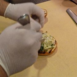 Applying the pickled jalapeno and cabbage slaw (tastes spicy, and cool).