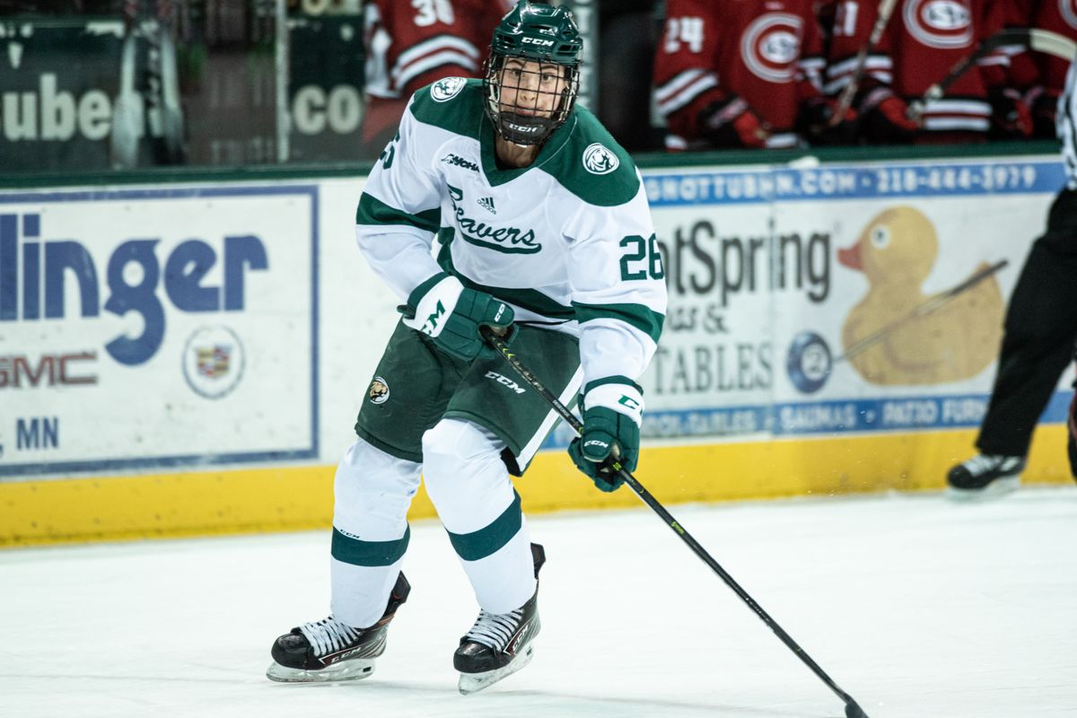 Bemidji State forward Clair DeGeorge (#26) carries the puck during a game against St. Cloud State.