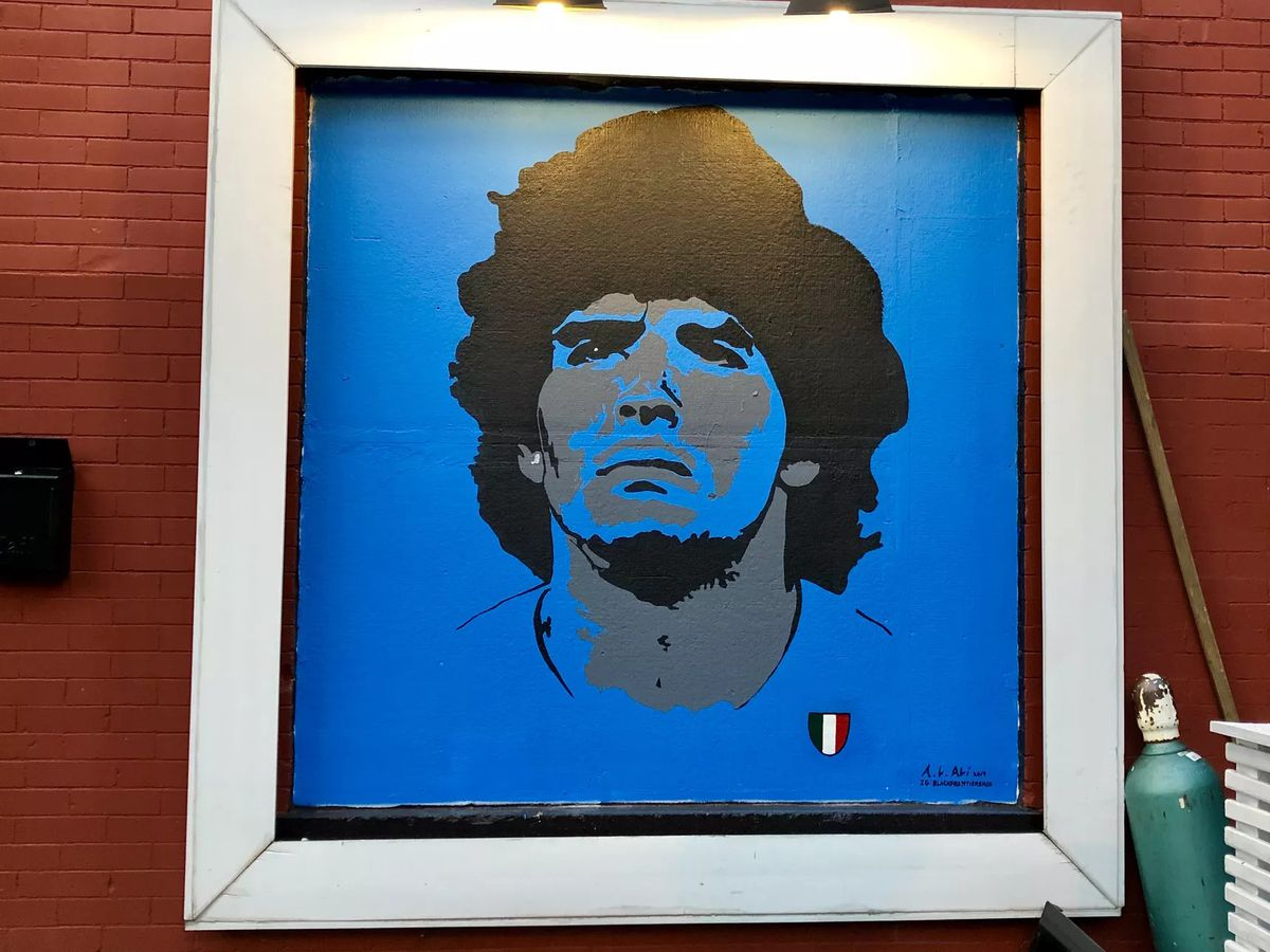 A mural of Argentine (and Napoli) soccer legend Diego Maradona outside of Napoli Pasta Bar