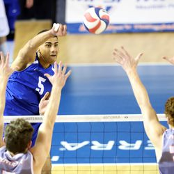 BYU's Gabi Garcia Fernandez hits the ball toward Spencer Wickens and Andersen Fuller as BYU and Pepperdine play in the finals of the Mountain Pacific Sports Federation Championship, at the Smith Field House in Provo on Saturday, April 24, 2021. BYU won in straight sets.