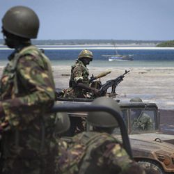 FILE - In this Wednesday, Dec. 14, 2011 file photo, Kenyan army soldiers sit in their armored vehicles next to the white sand shore of the seaside town of Bur Garbo, Somalia. Kenya's military said Friday, Sept. 28, 2012 that its troops attacked Kismayo, the last remaining port city held by al-Qaida-linked al-Shabab insurgents in Somalia, during an overnight attack involving a beach landing.