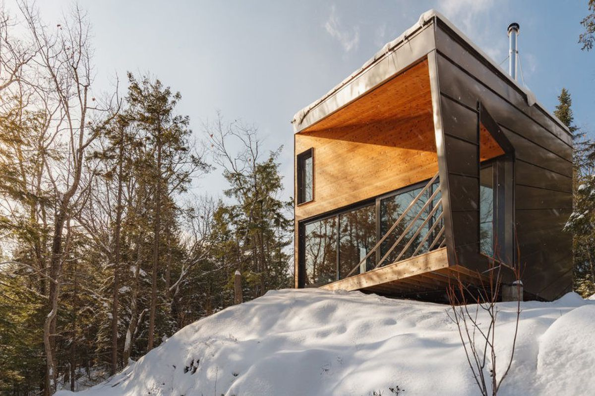 Prefab cabin is all wood glass and mountain views