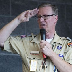 Roger A. Dibb, son-in-law to President Thomas S. Monson, gives the Scout salute during his remarks at the dedication of the Thomas S. Monson Lodge at the Hinckley Scout Ranch in the Uinta Mountains on Wednesday, Oct. 5, 2016.