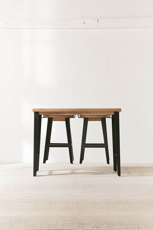 Two stools can be hung underneath the table.