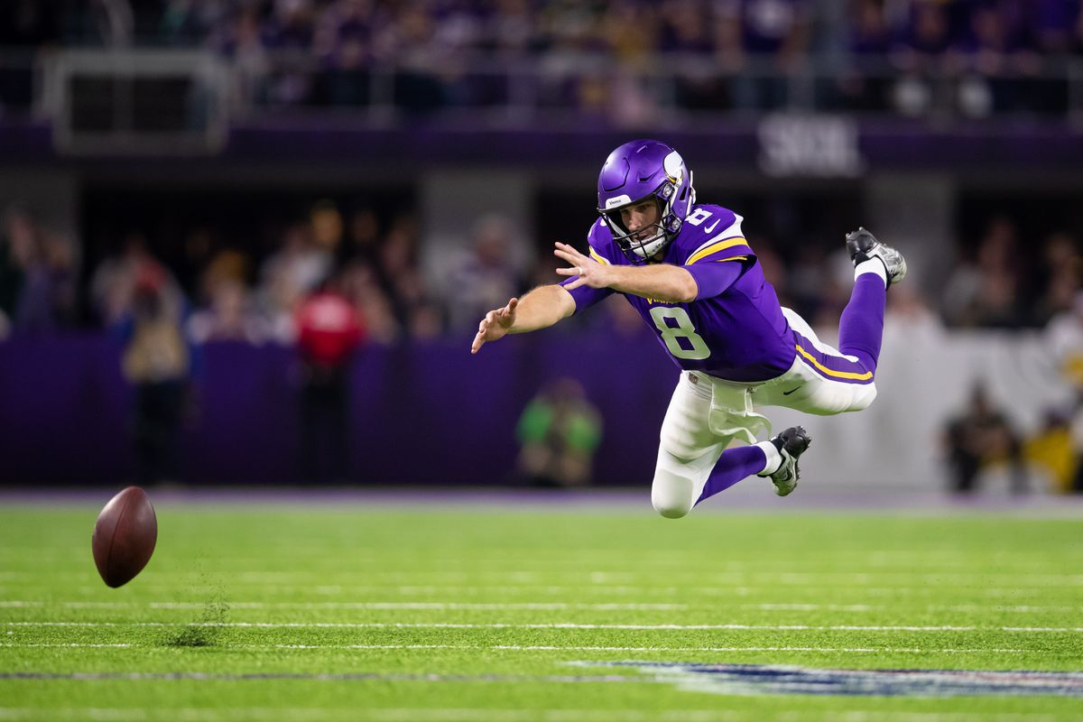 Minnesota Vikings quarterback Kirk Cousins misses a pass in the second quarter against Green Bay Packers at U.S. Bank Stadium.