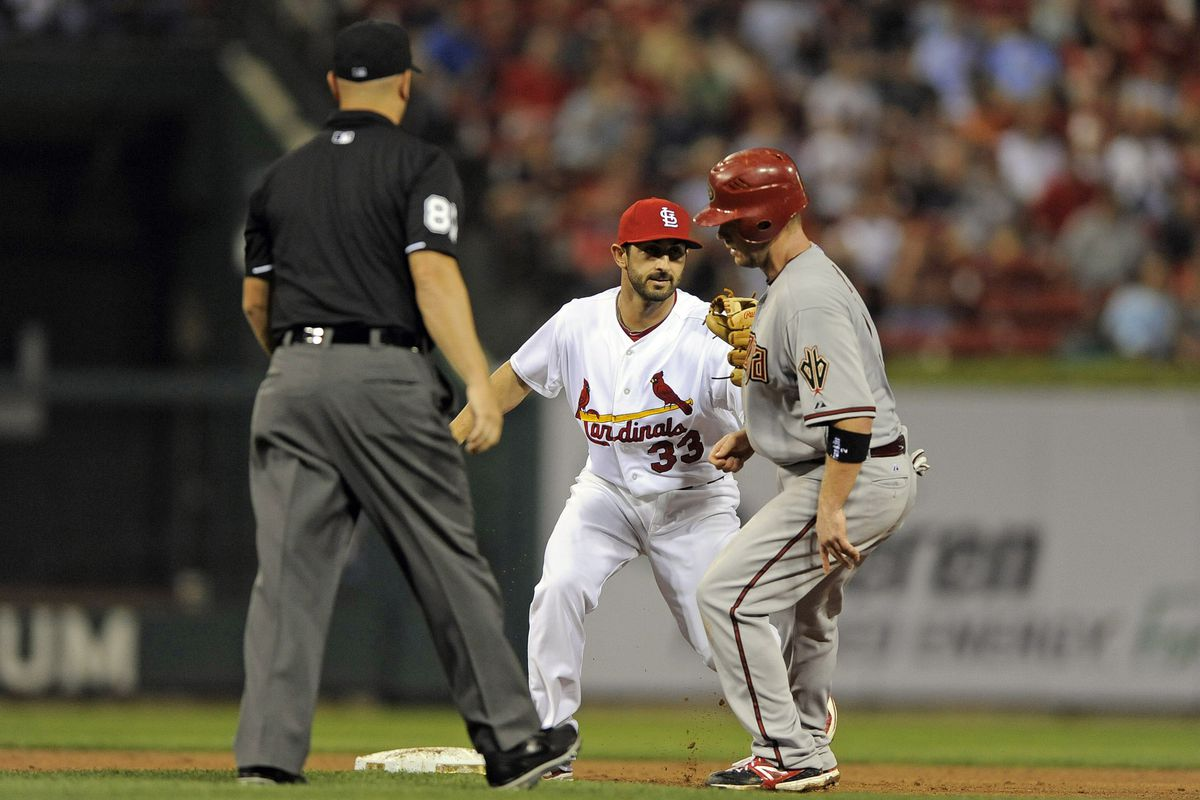 August 16, 2012; St. Louis, MO. USA; Arizona Diamondbacks second baseman Aaron Hill (2) is caught stealing by St. Louis Cardinals second baseman Daniel Descalso (33) during the fourth inning at Busch Stadium. Mandatory Credit: Jeff Curry-US PRESSWIRE