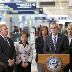 Transportation Security Administration chief Peter Neffenger, second from right, responds to a question at O'Hare International Airport on the massive delays at airport security lines in Chicago and across the country Friday, May 20, 2016, in Chicago. Joining Neffenger are from left, U.S. Senator Dick Durbin, D-Ill., U.S. Rep. Jan Schakowsky, D-Ill., U.S. Rep. Robin Kelly, D-Ill., Neffenger, and Chicago Mayor Rahm Emanuel. (AP Photo/Charles Rex Arbogast)